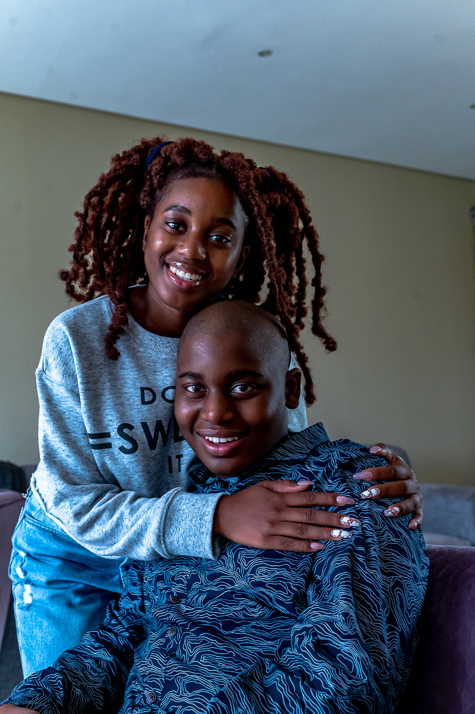 Picture of Zekwande and his Sister sharing a hug.